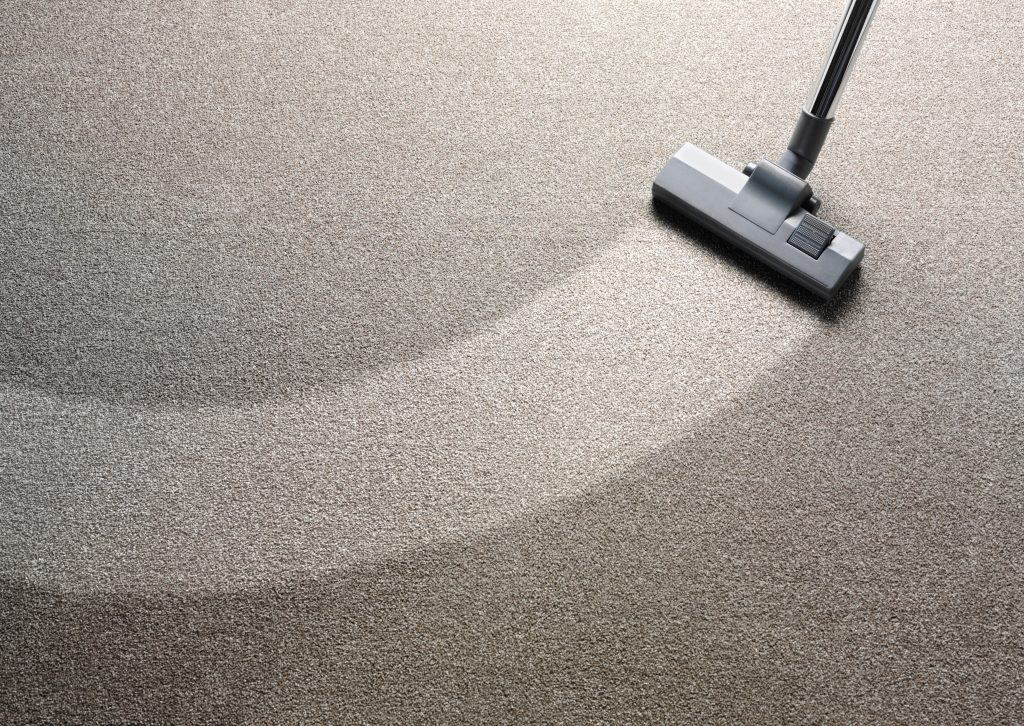 Use a high quality vacuum on your carpet to pick up debris from an old stain.