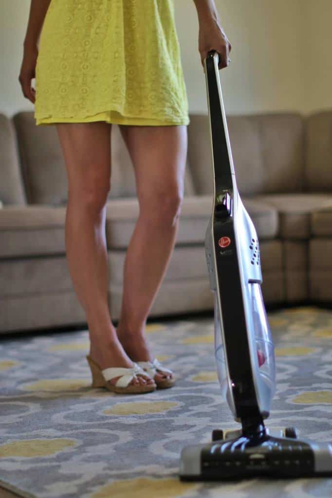The Hoover Linx vacuum being used in a living room by a woman