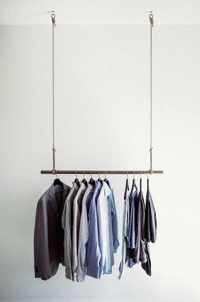 Clothes neatly hanging on a rack