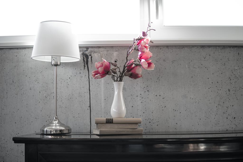 lamp on a table with flowers how to clean lamp shades