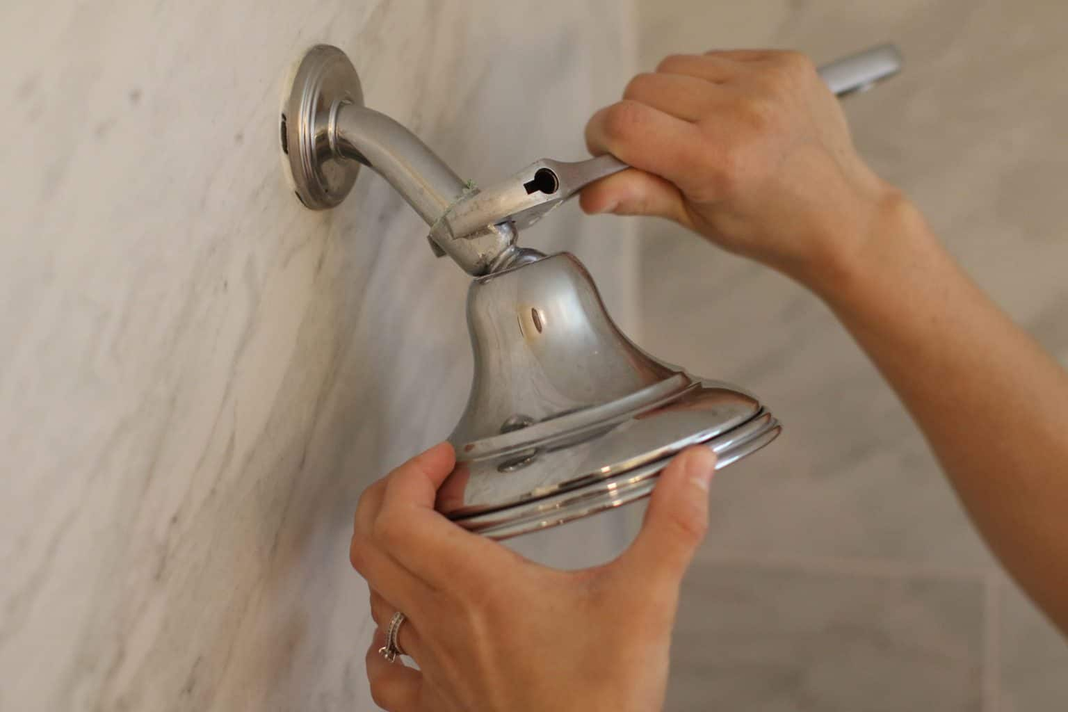 Removing a chrome shower head using a wrench