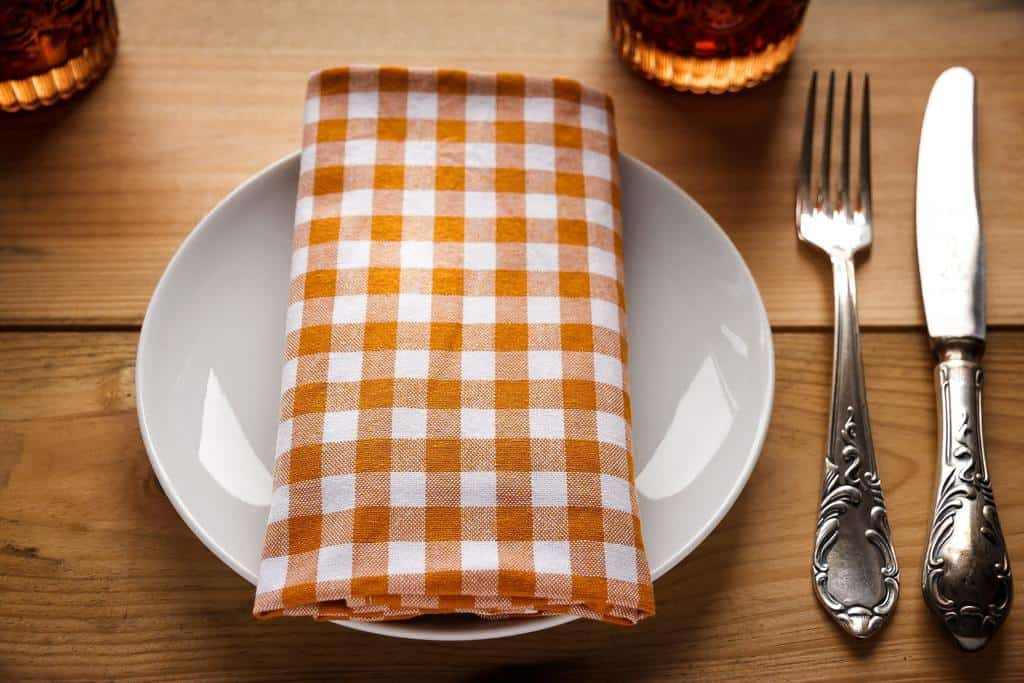 Dinner setting on with a checkered linen napkin