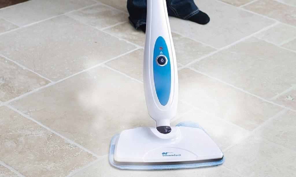 White steam mop used to clean white tiles