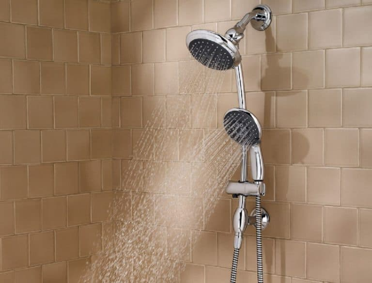 Two separate shower heads operating at the same time in a tile showere