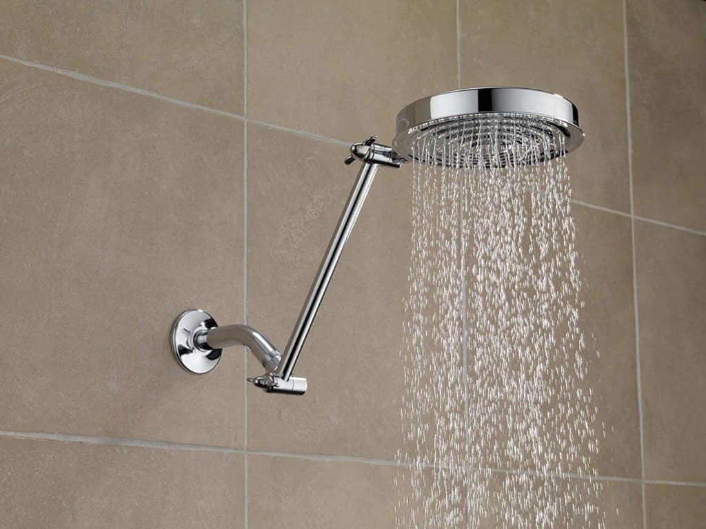 Angled shower head pipe in a tiled bathroom shower