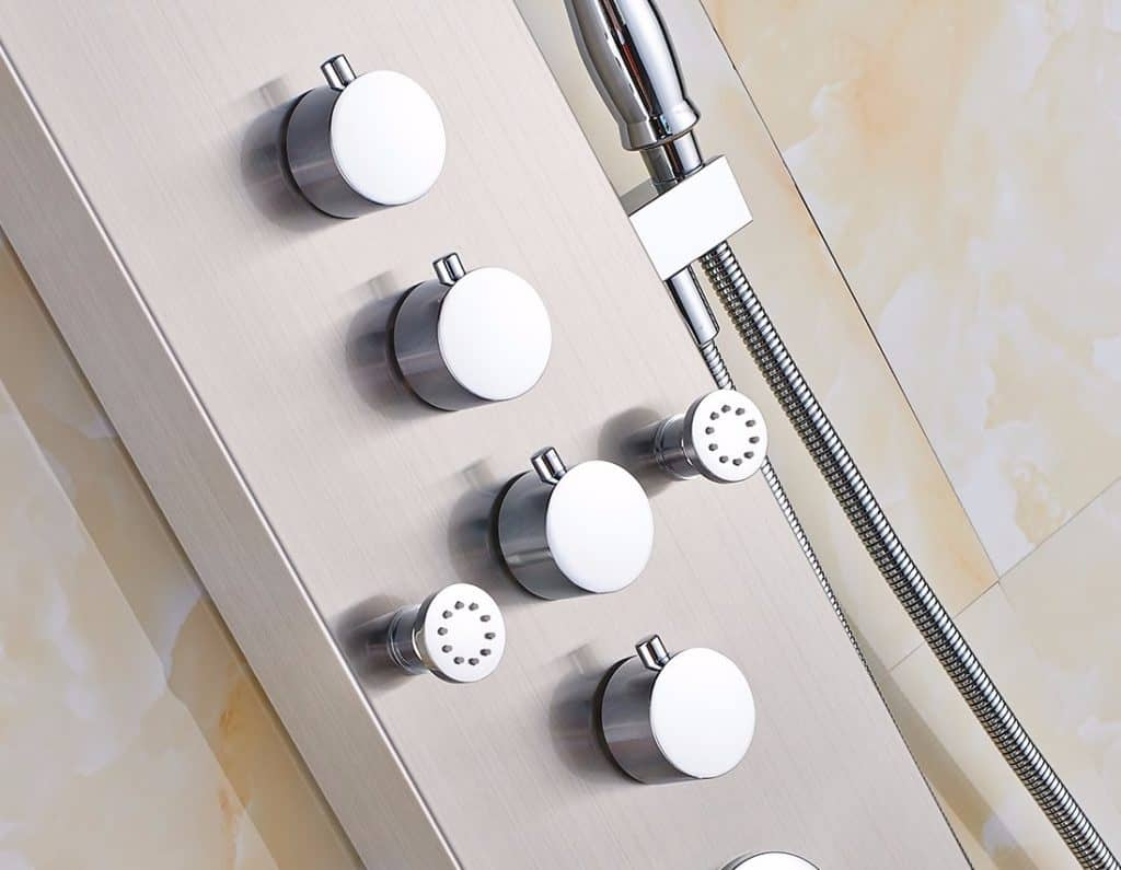 Close up of a white shower panel body with metal notches