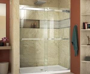 Glass shower doors in a marbled, orangey brown bathroom