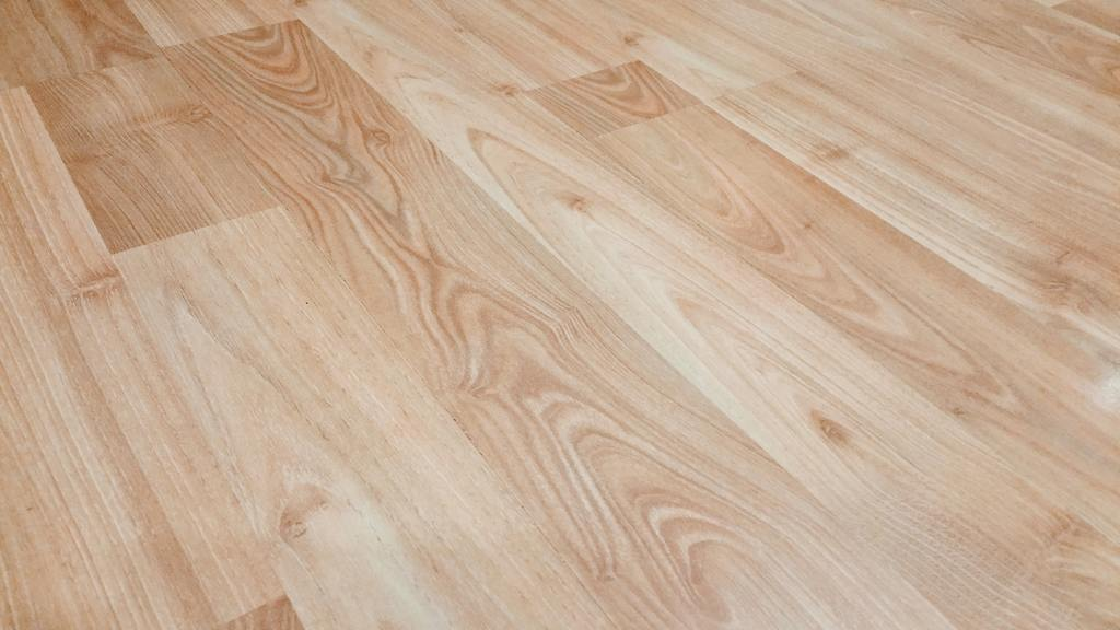 Close up of light colored laminate flooring