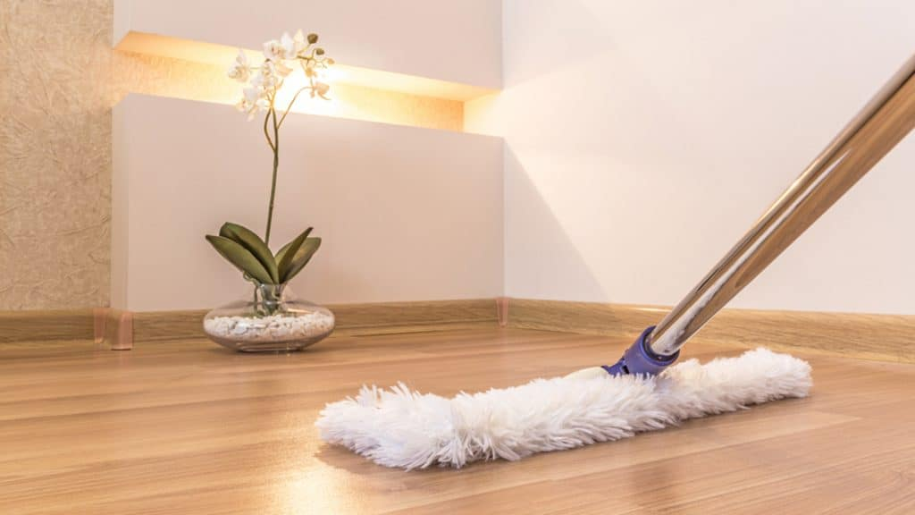 White Fluffy Mop Cleaning A Hardwood Floor
