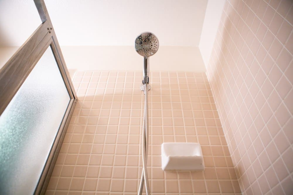 A handheld showerhead mounted inside of a shower