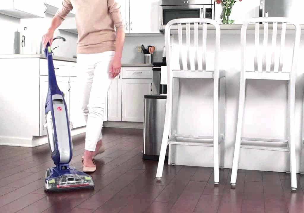 Woman using a vacuum on hardfloor
