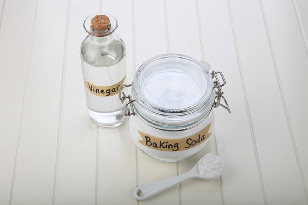 Two jars labeled baking soda and vinegar