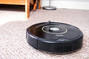 Close up of the roomba on carpet