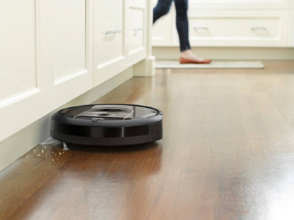 Robot vacuum cleaning underneath kitchen cabinets
