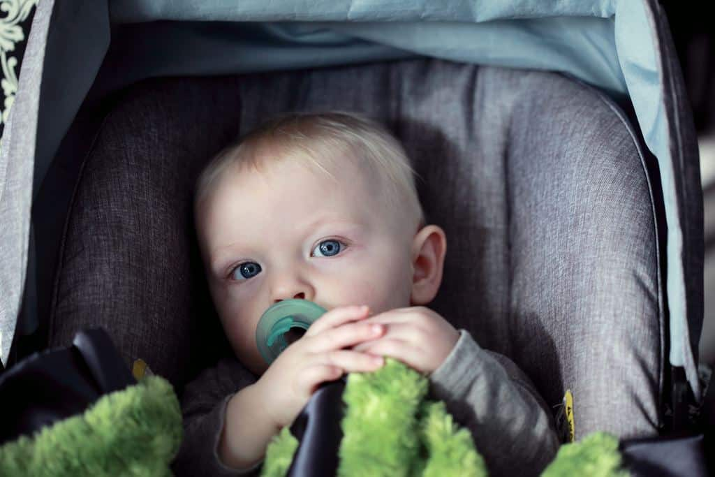 Baby in a child car seat