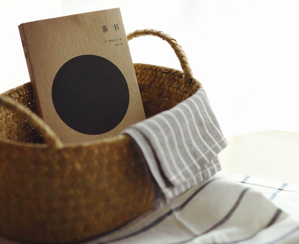 Book in a brown woven basket