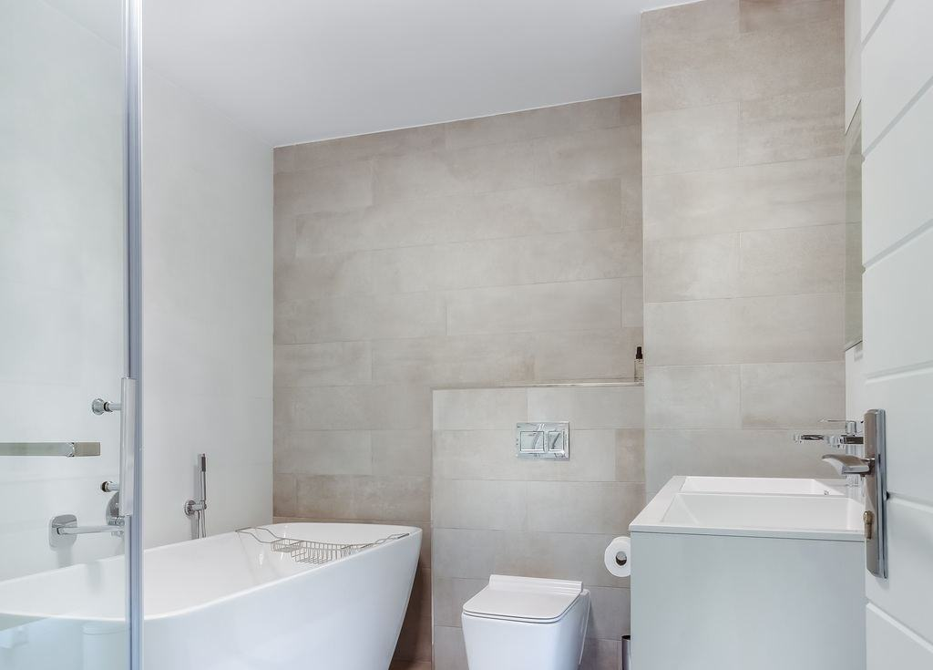 A clean bathroom with travertine tiles