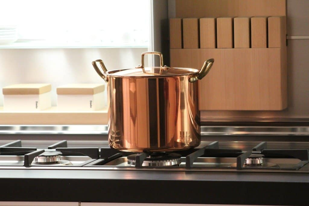 A clean copper or brass pot on a stove