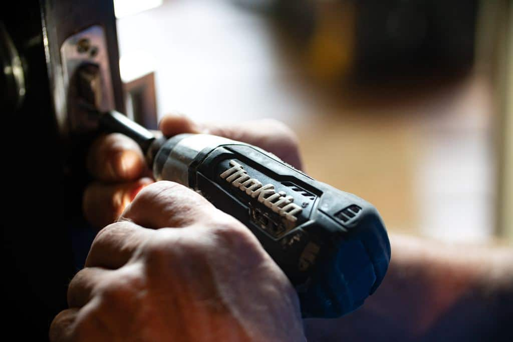 A man drills with his cordless drill