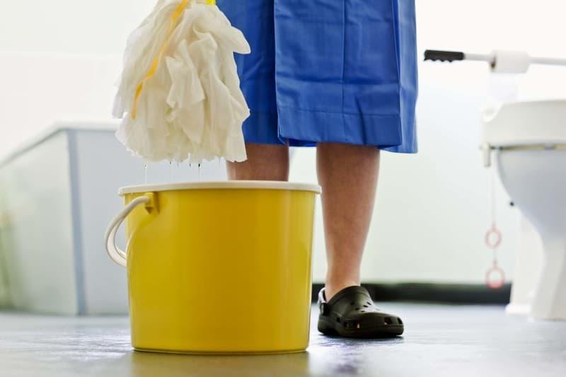 Woman mopping bathroom floor