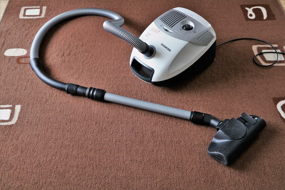 Vacuum cleaner left on a carpet