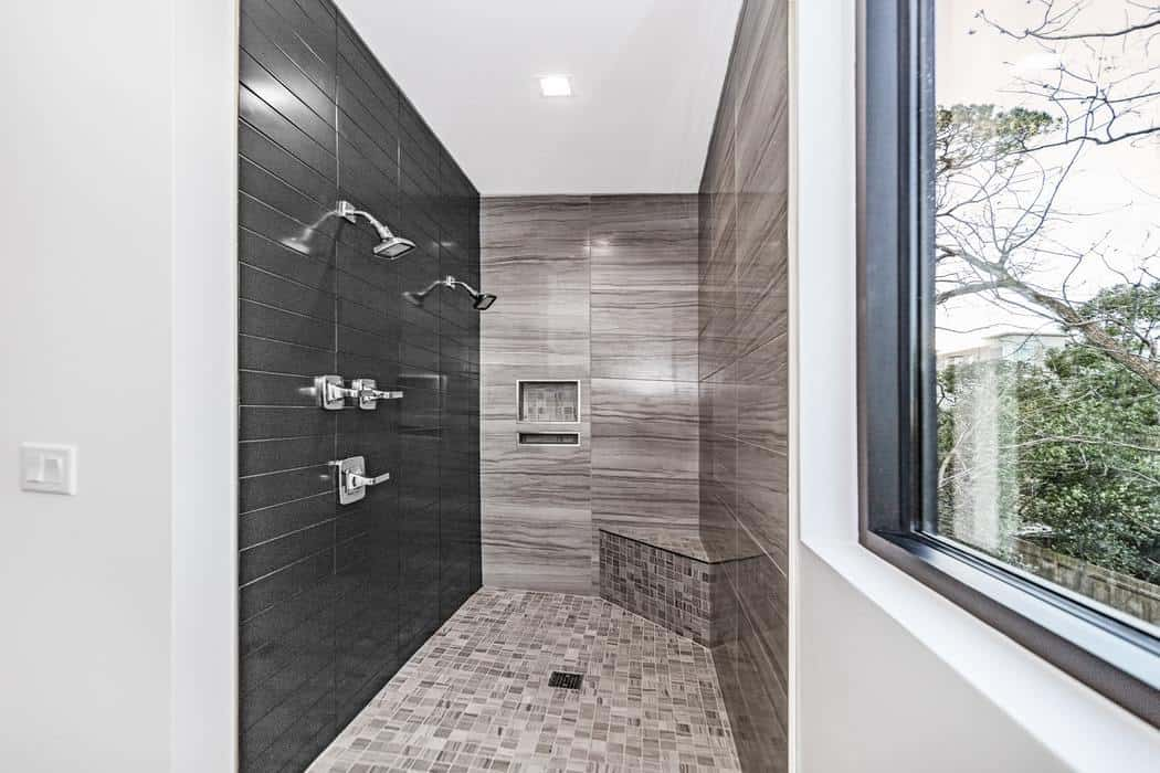 Shower room with brown tiled walls