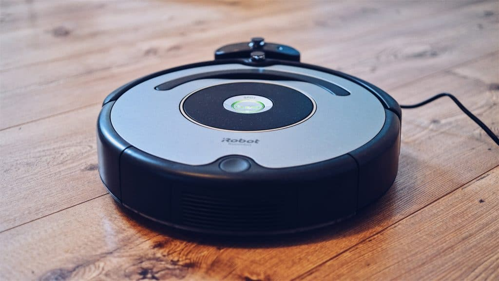 Robot vacuum being used on a vinyl plank floor