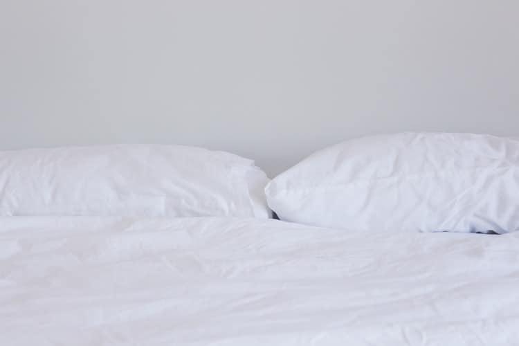 Two pillows placed above a mattress