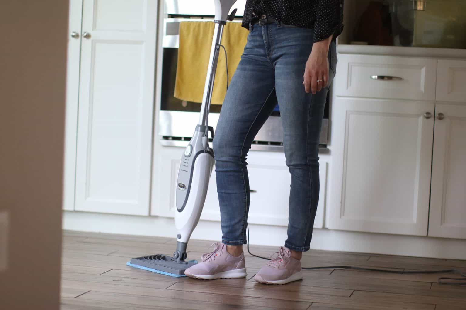 Woman about to use her steam cleaner