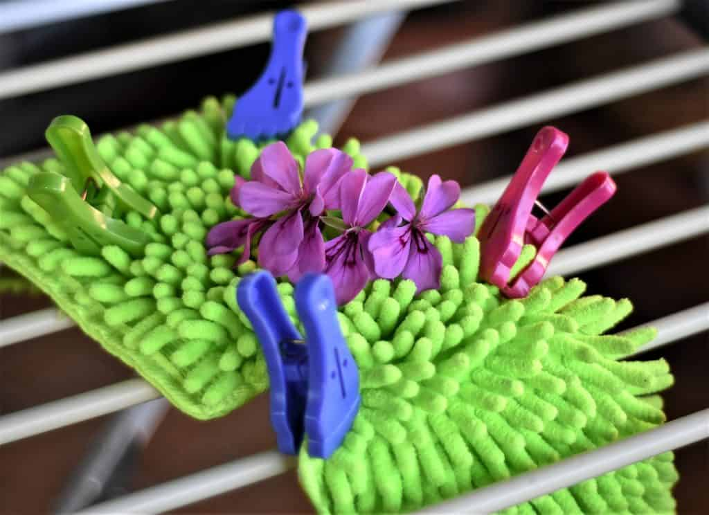 Microfiber mop head drying on a rack