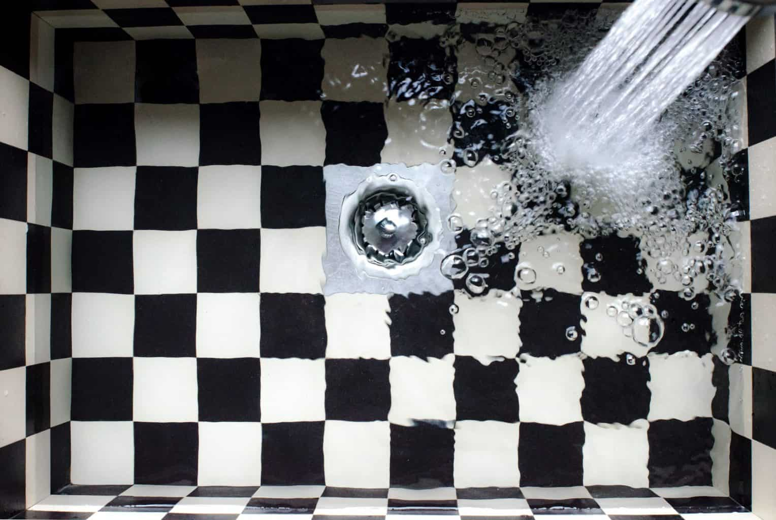 Water flowing in a shower drain hair catcher