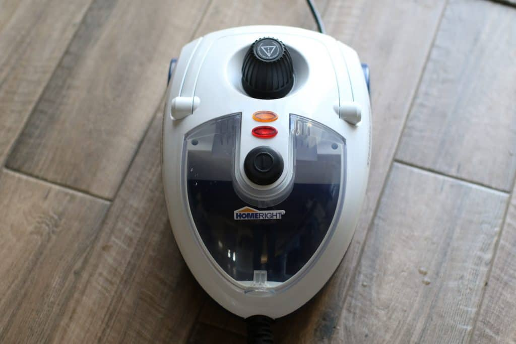 Commercial steam cleaner placed on the floor