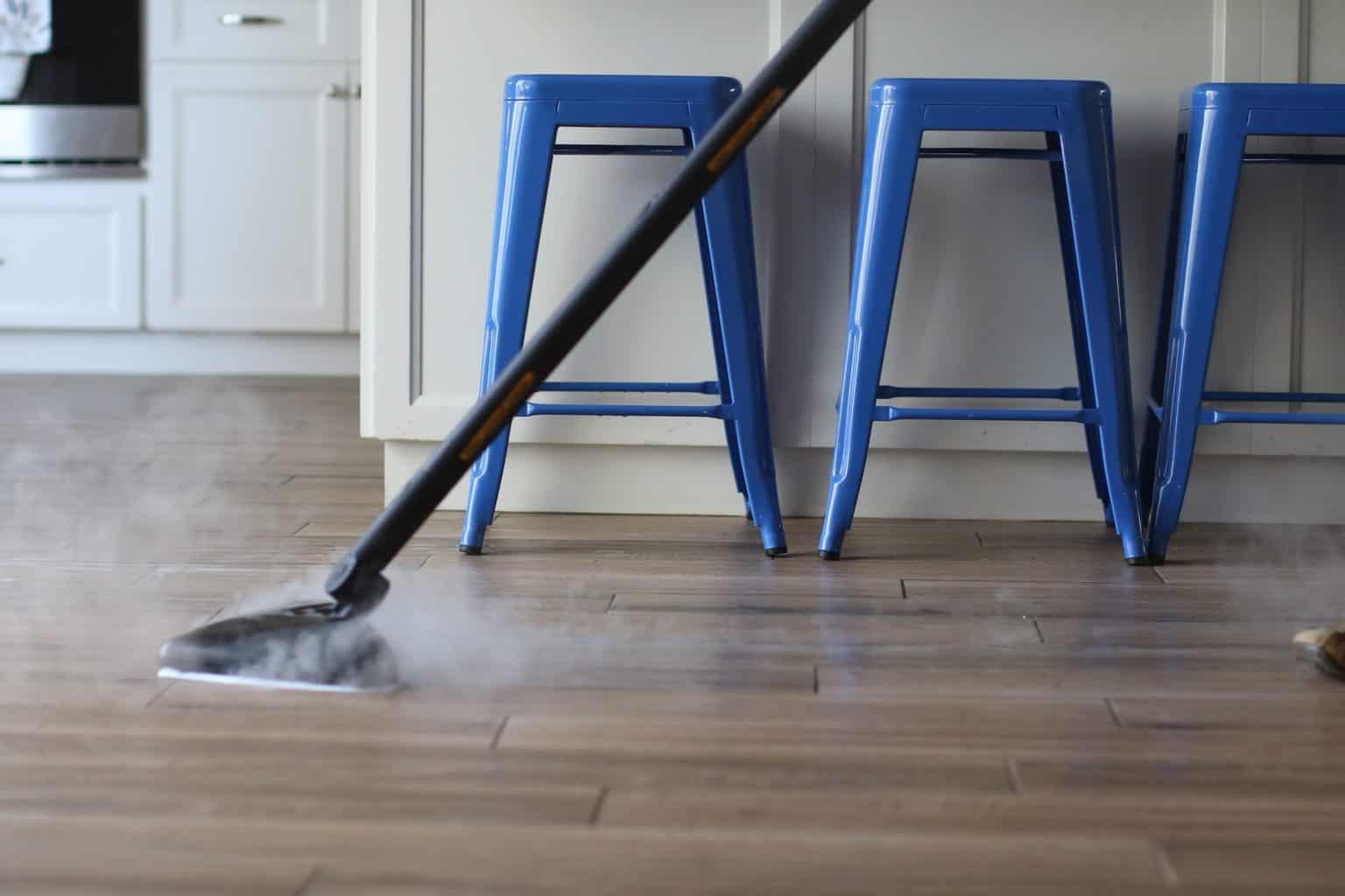 Steam mop cleaning a wooden floor