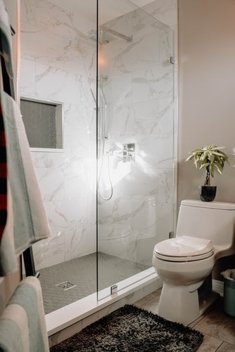 Modern shower with a toilet beside it