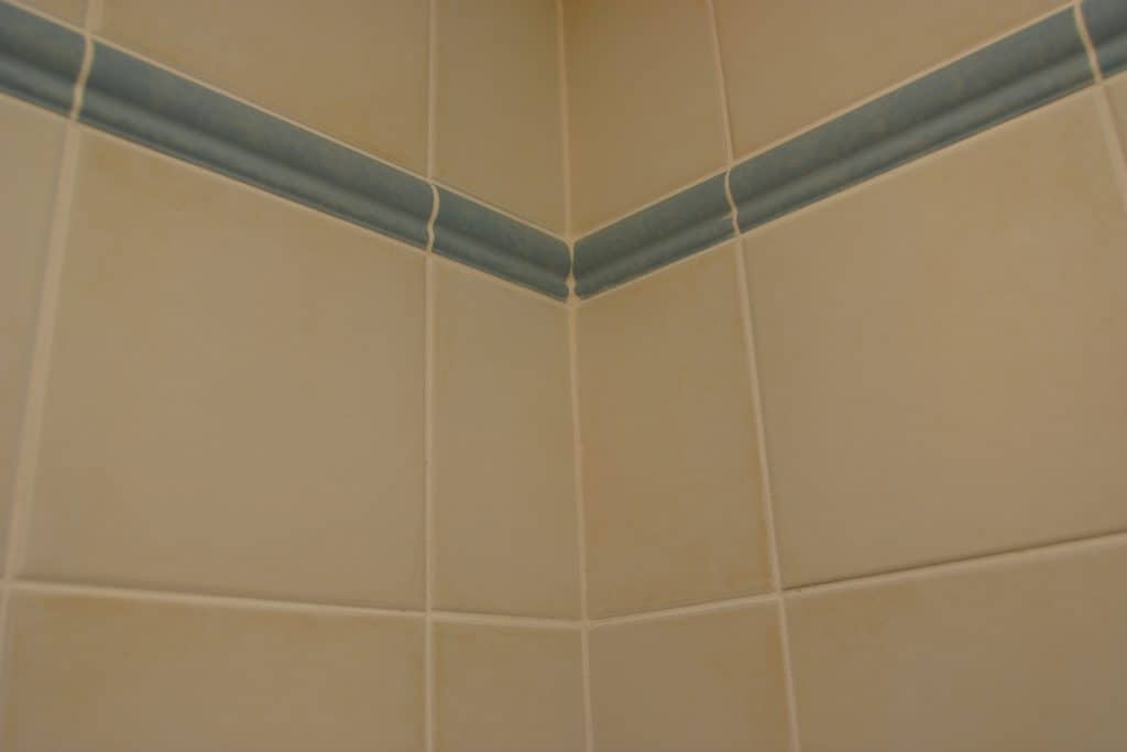 Newly applied shower caulk in the bathroom tiles