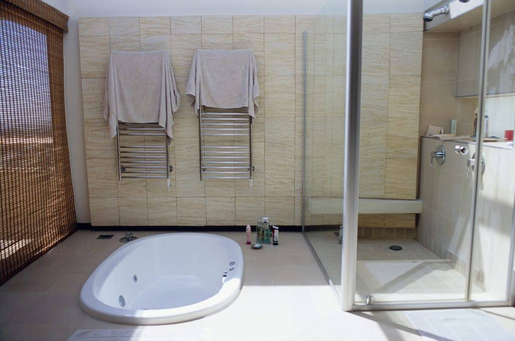 Bathroom with a tub and shower door
