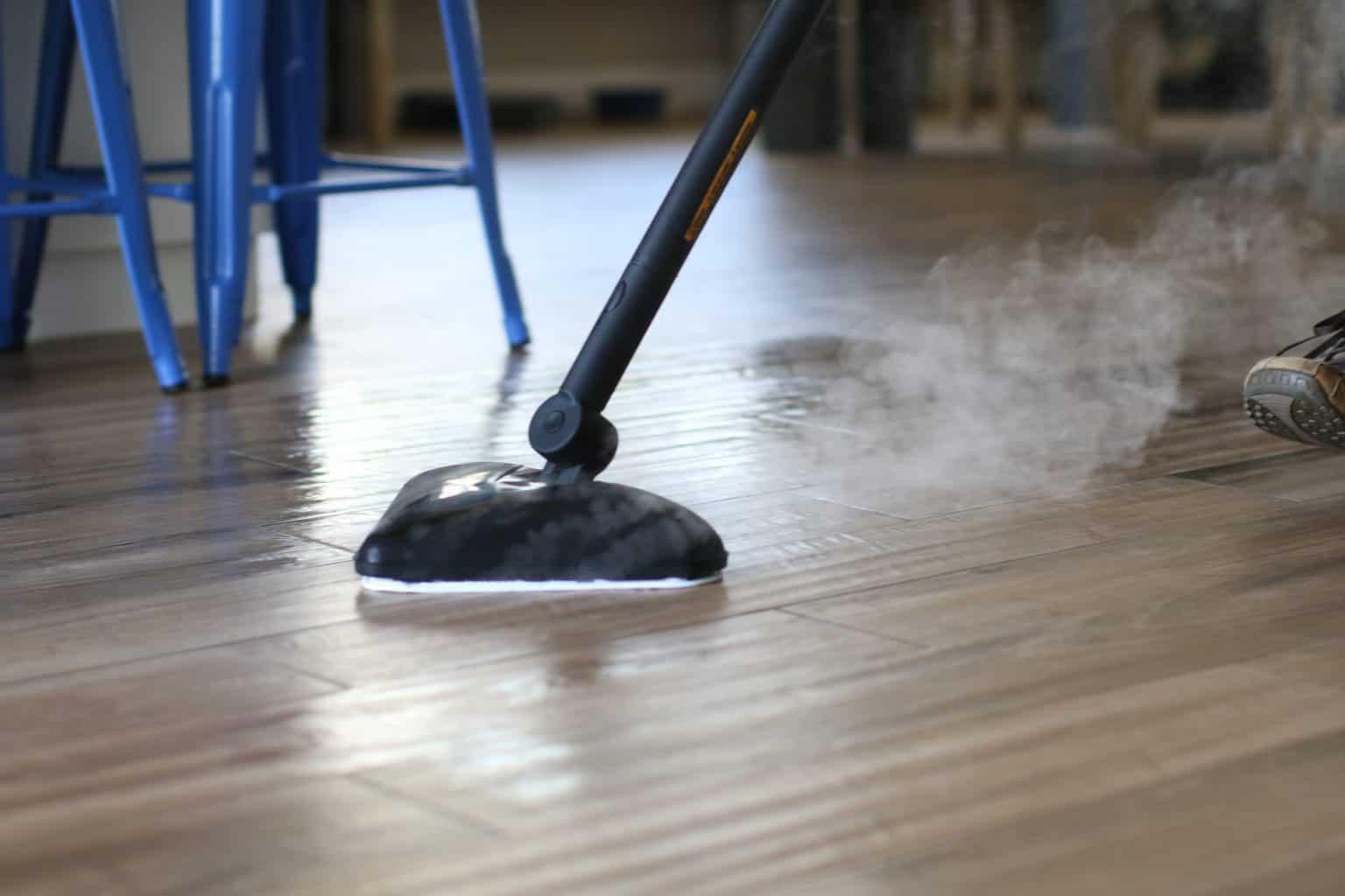 Steam mop being used to clean vinyl floors