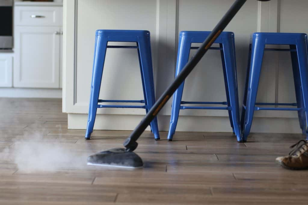 Steam mop cleaning a wood floor