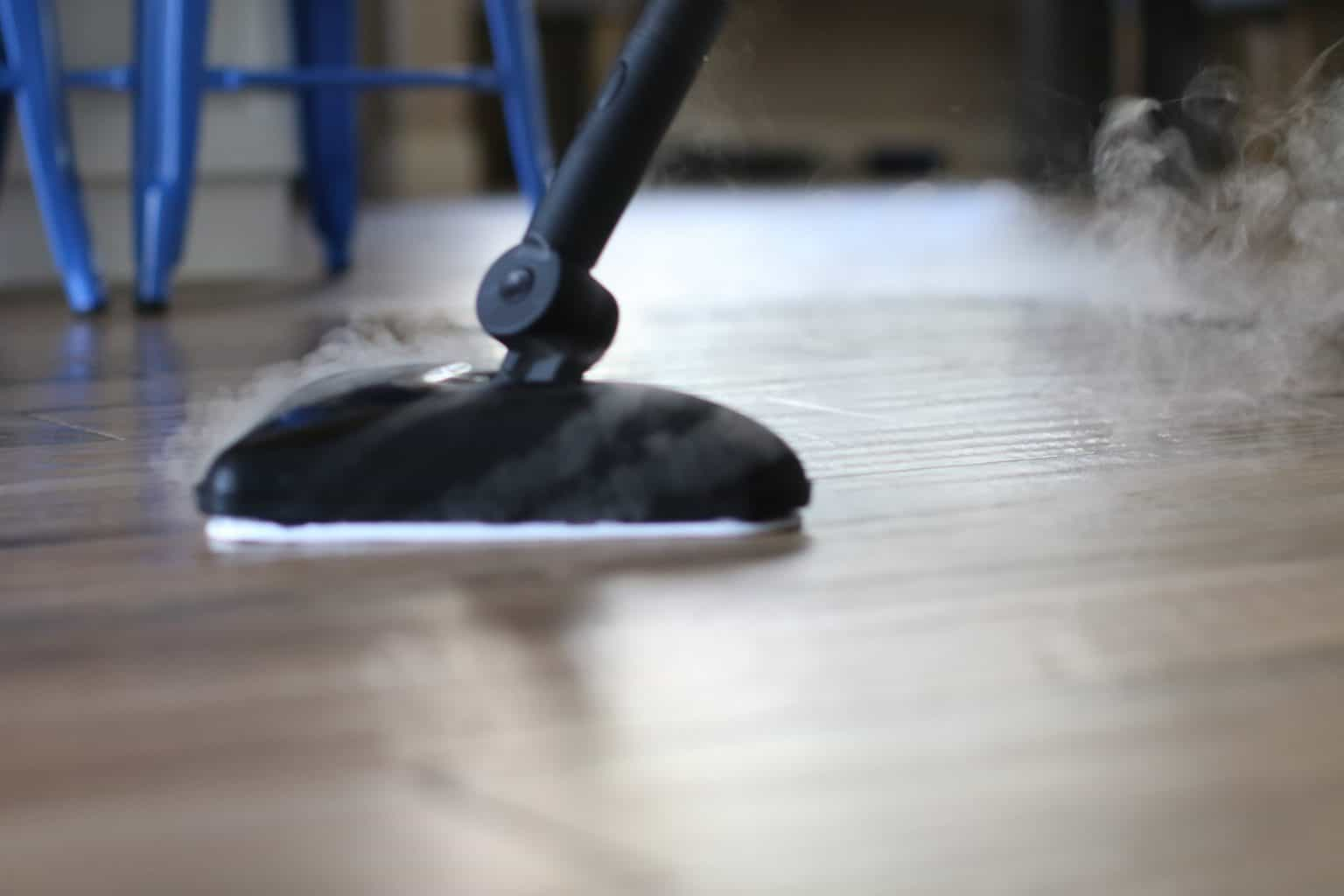 Steam mop being used for wood floors