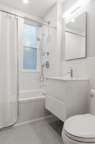 White bathroom with tub