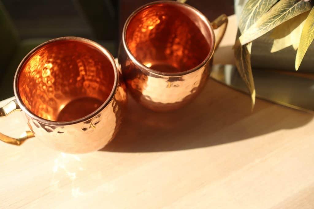 A pair of clean copper mugs