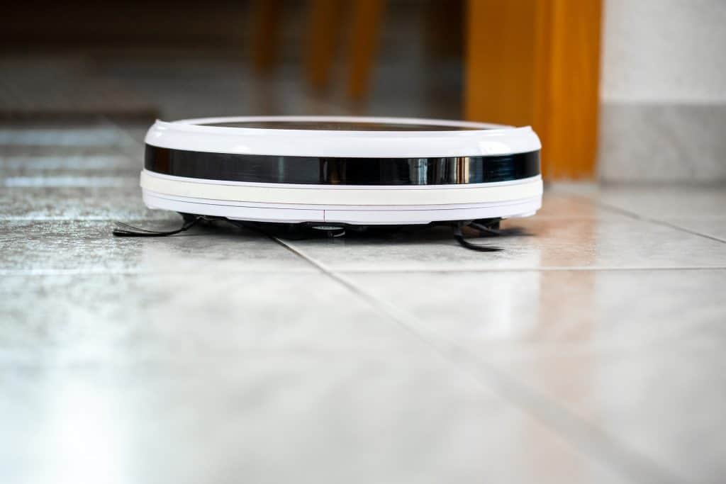 a white Roomba on the floor