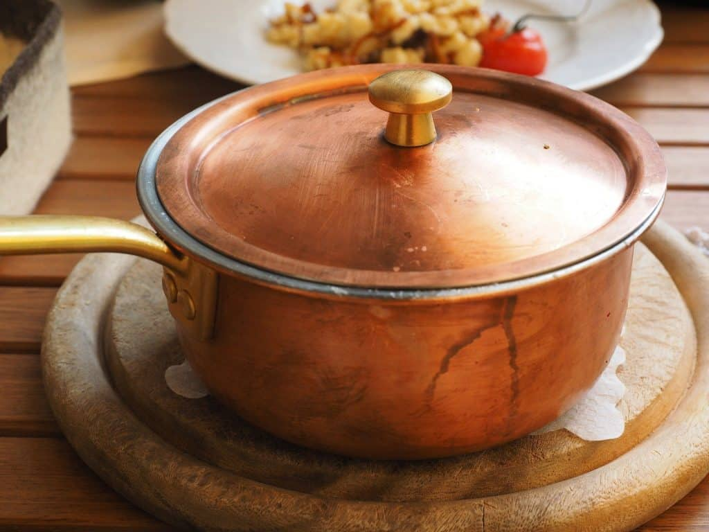 a clean tarnished copper pot