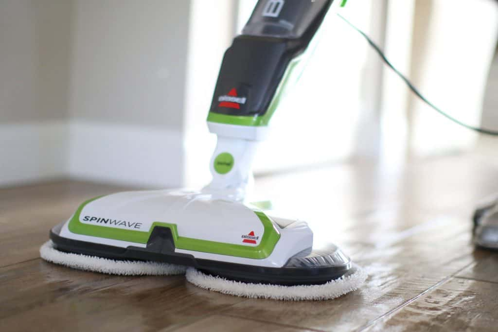 BISSELL mop being used for dry mopping