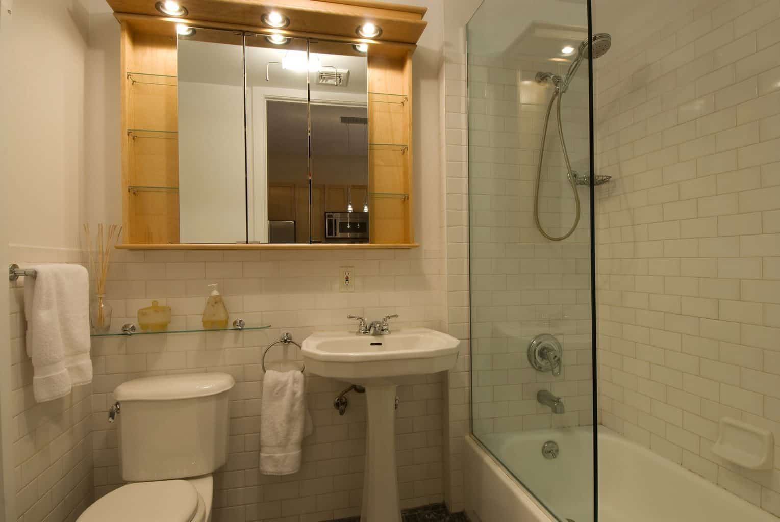 Bathroom with a low flow handheld shower head