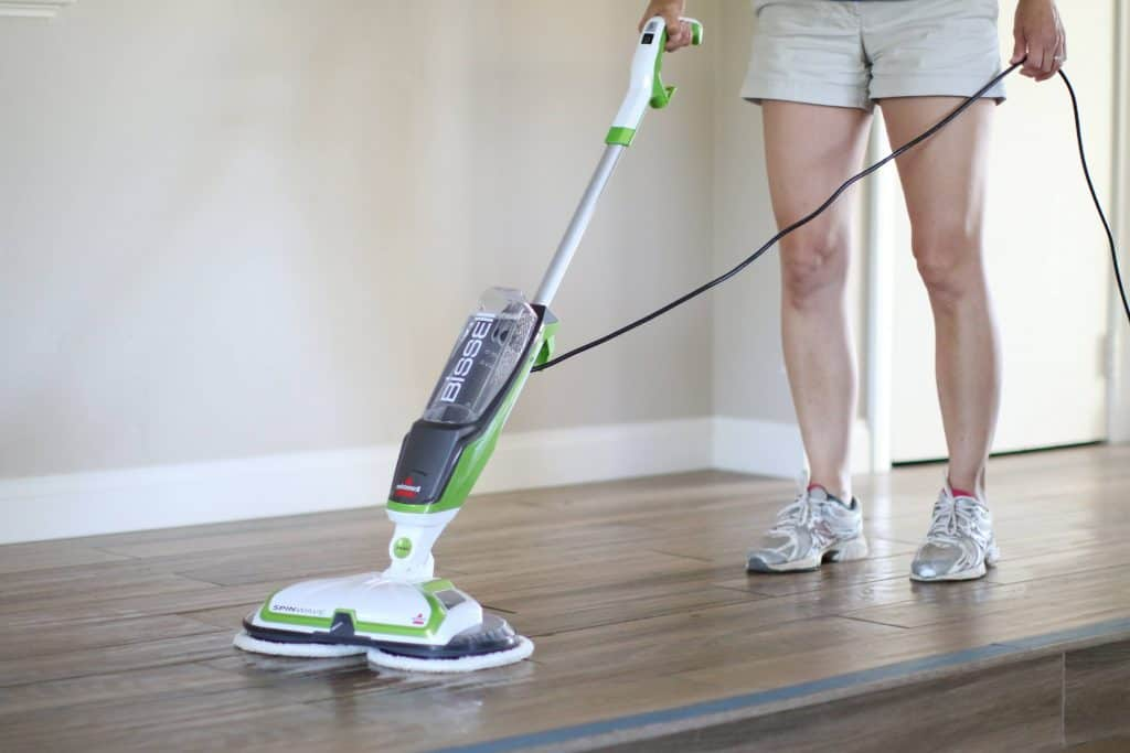 Person using a microfiber mop