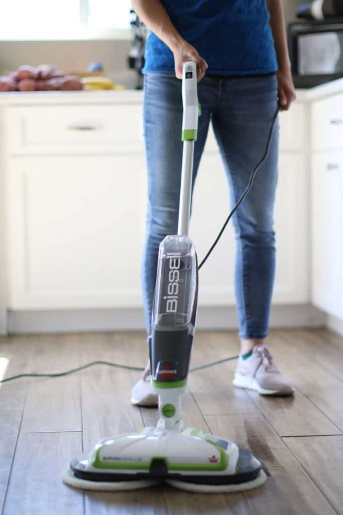 Person using mop to clean the floor