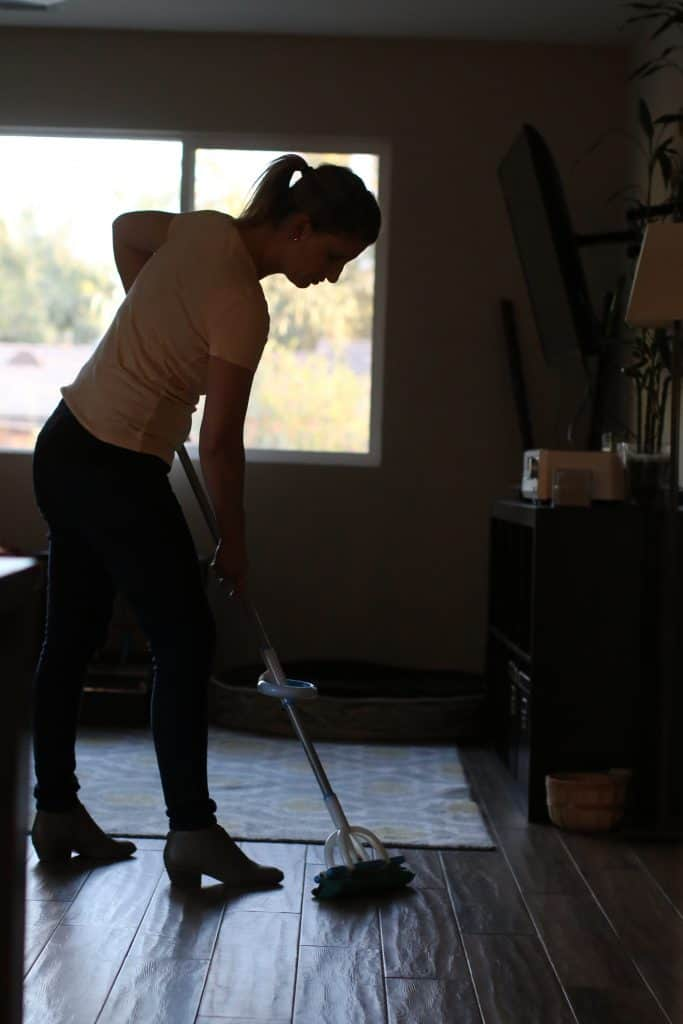 Woman using a mop for tile floors and grout