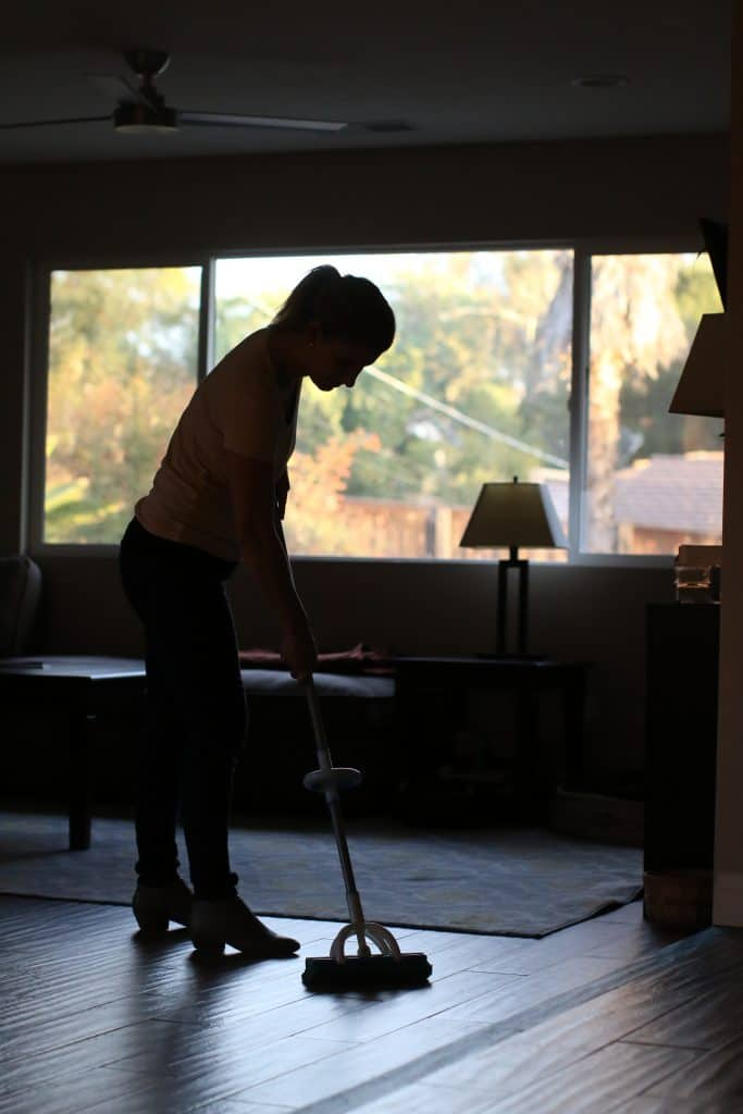 Woman mopping her floor