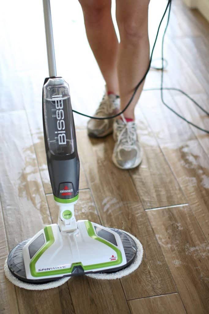 Person using soap for mopping wood floors